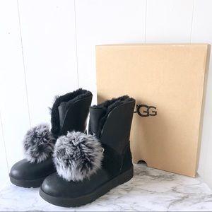 Ugg NWT Isley Black Leather Suede Pom Pom Boots 7